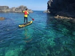 SUP and clear blue water on the coast