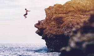 Coasteering - Jumping off a ledge into the sea