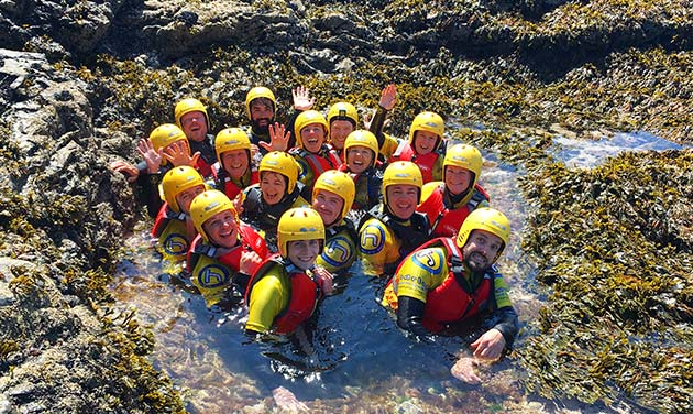 Coasteering in cornwall - group in deep pool