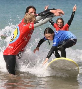 Girl Surfing in Surf Lesson
