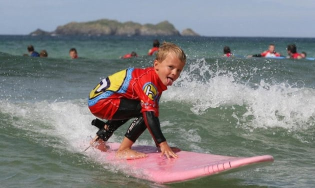 Child learning to surf